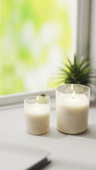 Scented candle, burning white aromatic candles in glass on white surface with green plant 3d rendering