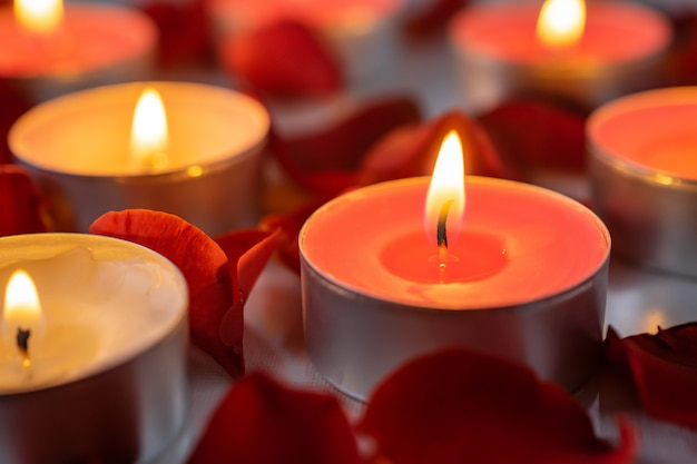 Scented candles with rose petals, warm and cozy background