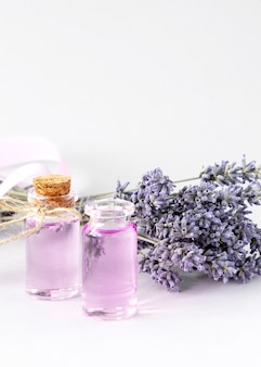 Scented lavender oil soap bar  with a dried bouquet of lavender white towels Premium Photo