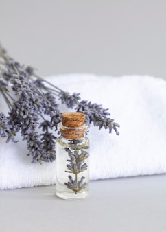Scented lavender oil soap bar  with a dried bouquet of lavender white towels