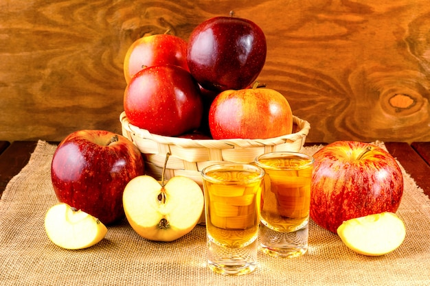 Schnapps drinks and apples in the wicker basket