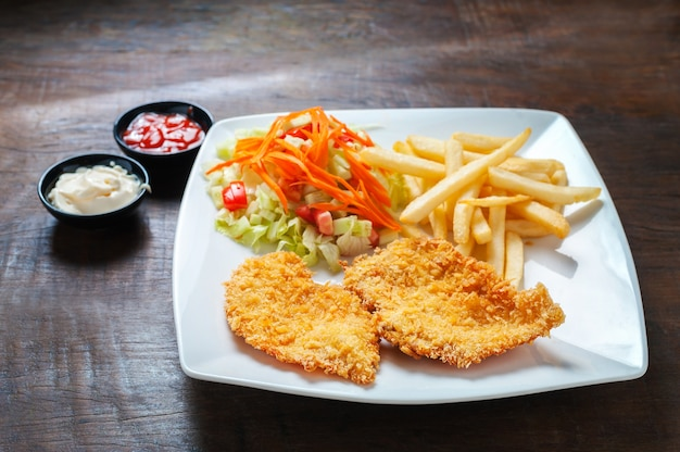 Schnitzel with french fries and vegetable.