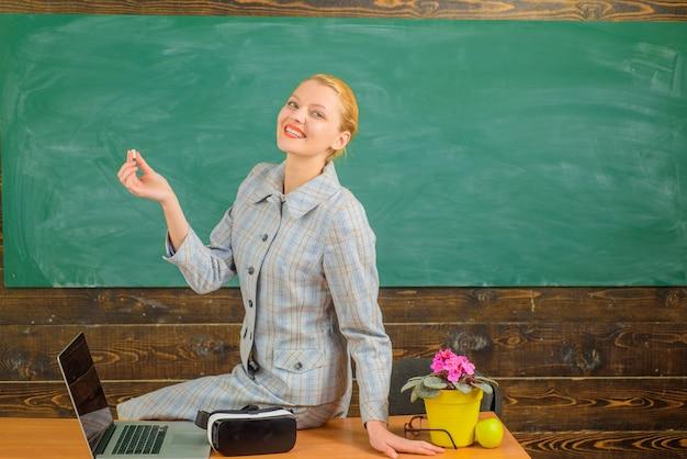 Scholarship back to school female teacher in classroom education concept school smiling teacher in
