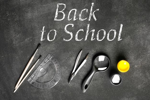 School accessories on the black chalkboard