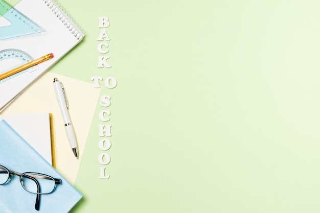 School accessories on light green background