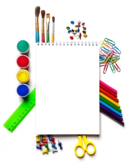 School and art supplies laid out on white