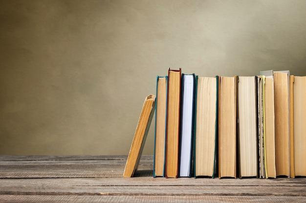 School blackboard with pile of books