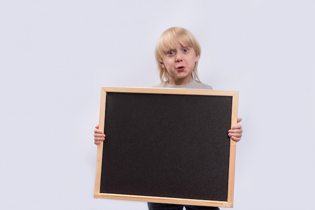 School board in the hands of boy on white background. copy space. template. mockup