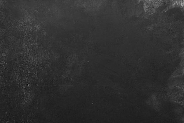 チョークの痕跡、空の黒板の背景を持つ教育委員会