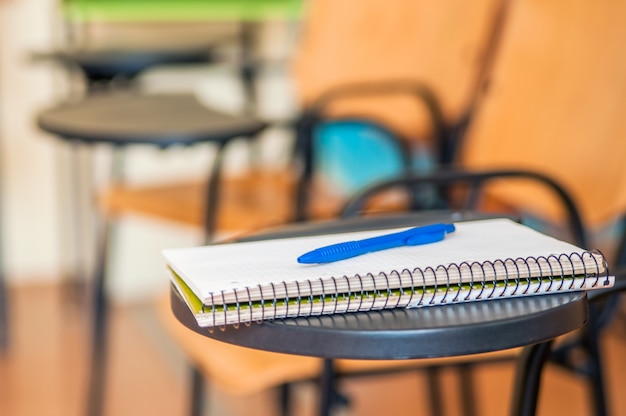 School book on desk, education concept