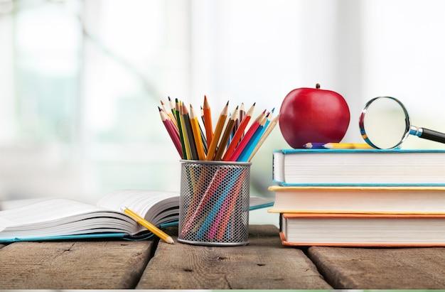 School books ,color pencil ,pen on desk,can creative infographics blackboard inside ,