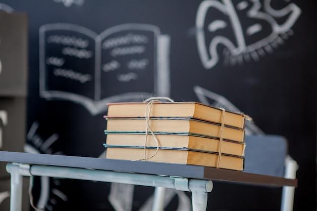 School books on school desk