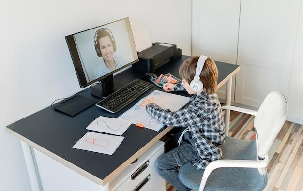 School boy taking online courses long shot
