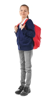 白い背景の上のバックパックを持つ学童。間違った姿勢の概念