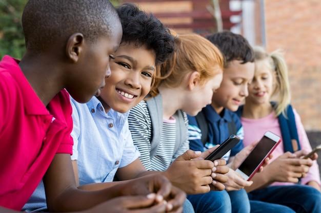 School children using phones