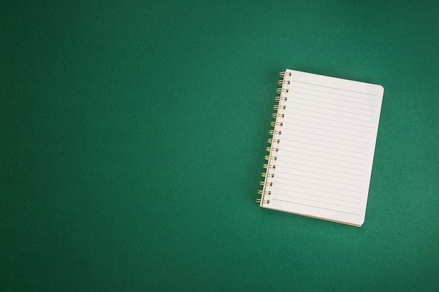School clear notebook on a green background.