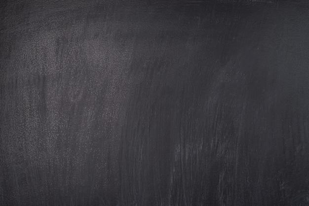 학교 개념입니다. 얼룩진 검은 칠판의 클로즈업 사진