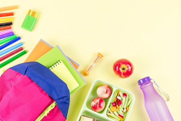 School concept flat lay, kid backpack, lunchbox, water bottle, notebook, markers