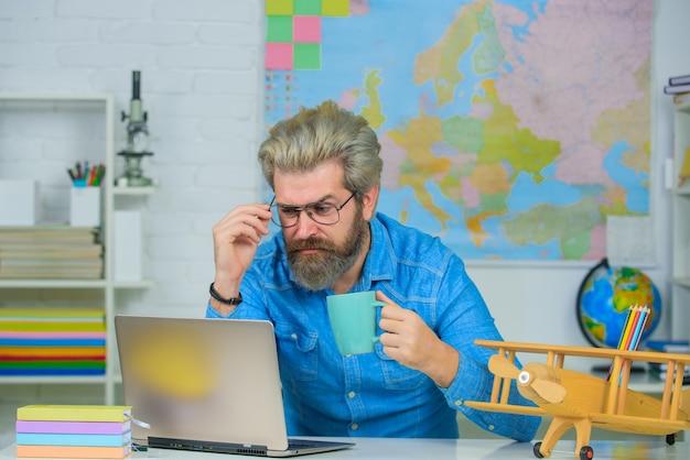 School concept learning education teacher september teacher in classroom man teacher with laptop