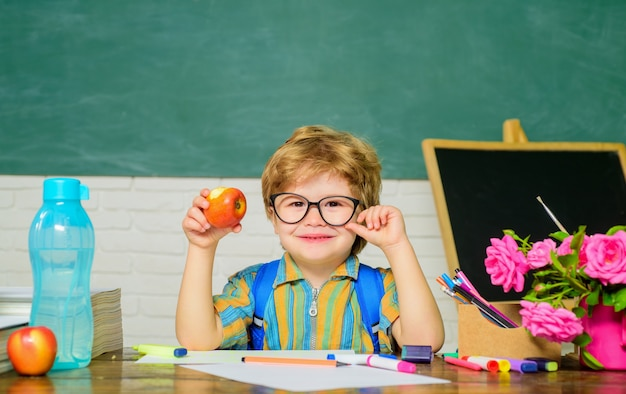 School concept schoolboy in glasses education and learning little schoolboy in classroom education
