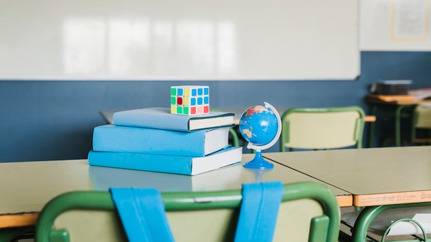 School desk with books and rubik cube
