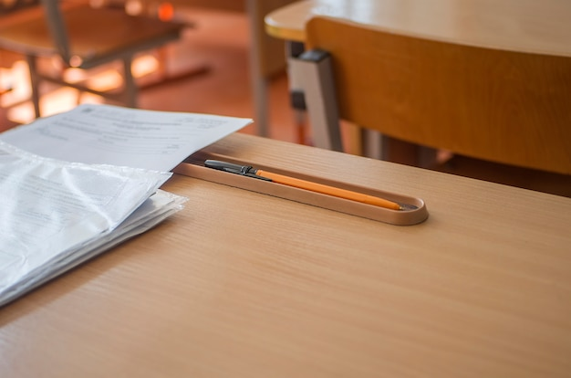 School desk with papers and pencil