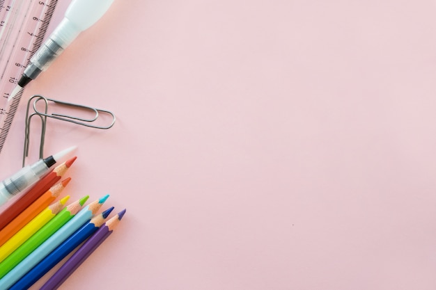 School drawing supplies on pink background. copyspace