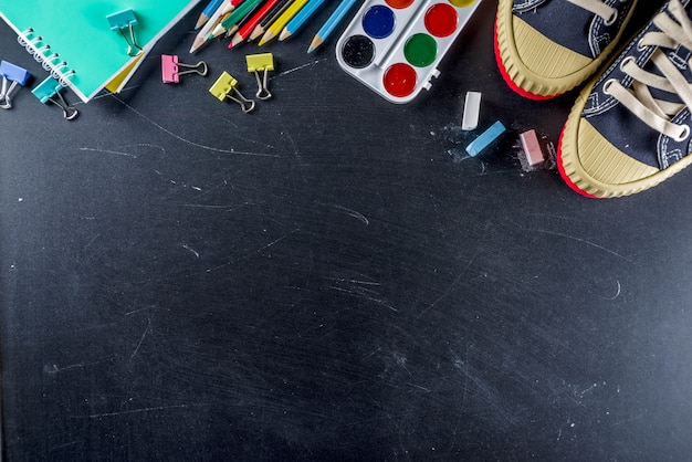 School education supplies on chalkboard background