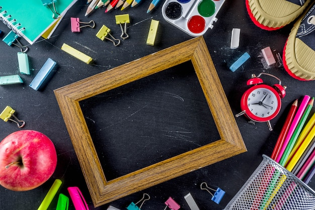 School education supplies on chalkboard background