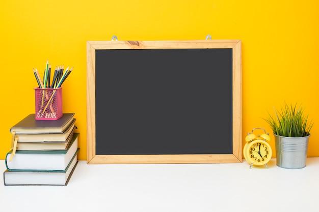 School equipment on yellow background, education background concept school equipment on yellow background, education background concept