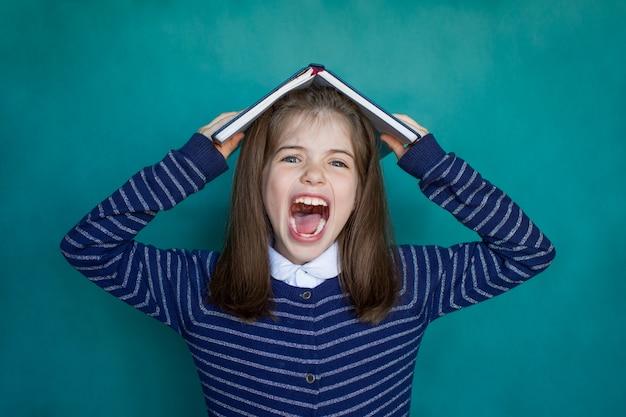 School girl screams, educational and school concept