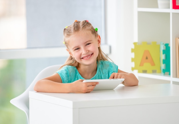 School girl using tablet