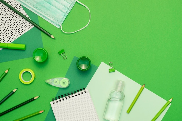 School items on green background