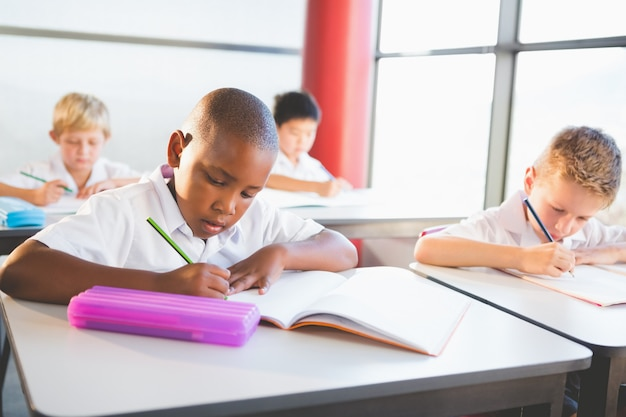 School kids doing homework in classroom