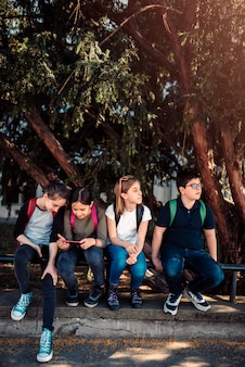 School kids hang out at schoolyard