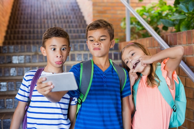 School kids taking selfie from mobile phone