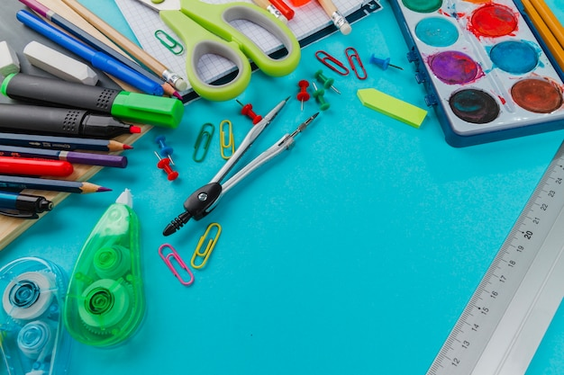 School kit in mess on blue background