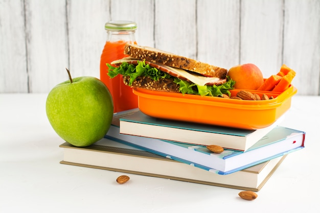 School lunch box with sandwich, fruits and nuts