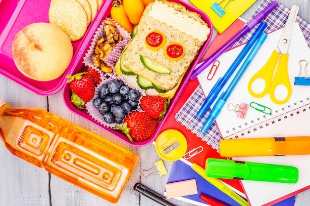 School lunch box with school supplies