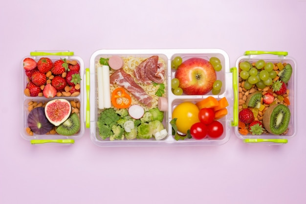 School lunch boxes with set of fruits, berries and vegetables