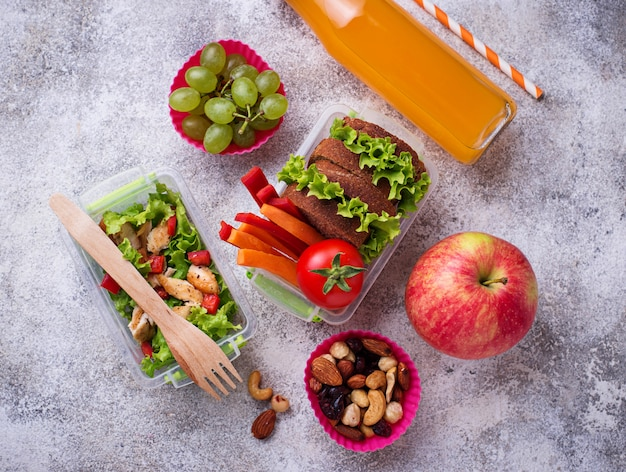 School lunch. salad, sandwiches, fruits and nuts