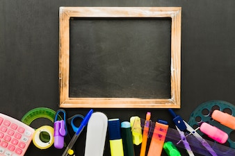School materials and blackboard