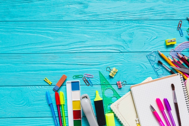 School materials on colorful table