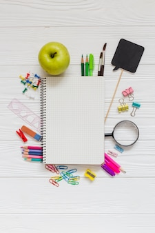 School materials, notebook and apple