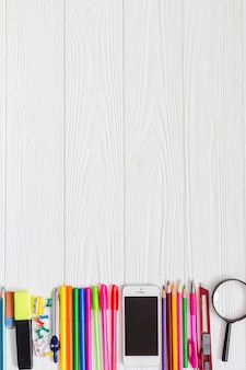 School materials with smartphone