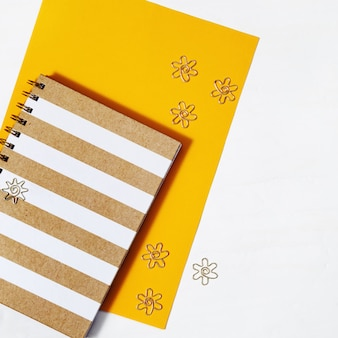School notebook on spring and gold metal clips