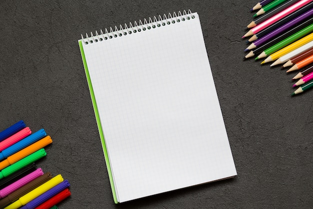 School notebook and various stationery. back to school concept.