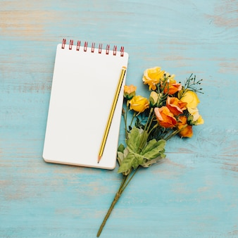 School notebook with copy space and bouquet.
