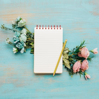 School notebook with copy space and flowers.