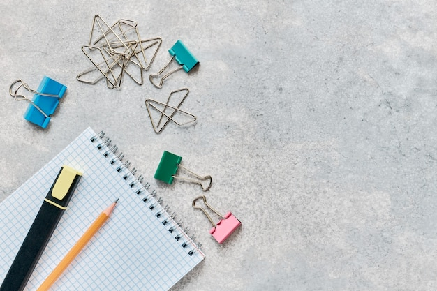 School and office stationery on a gray background with copy space